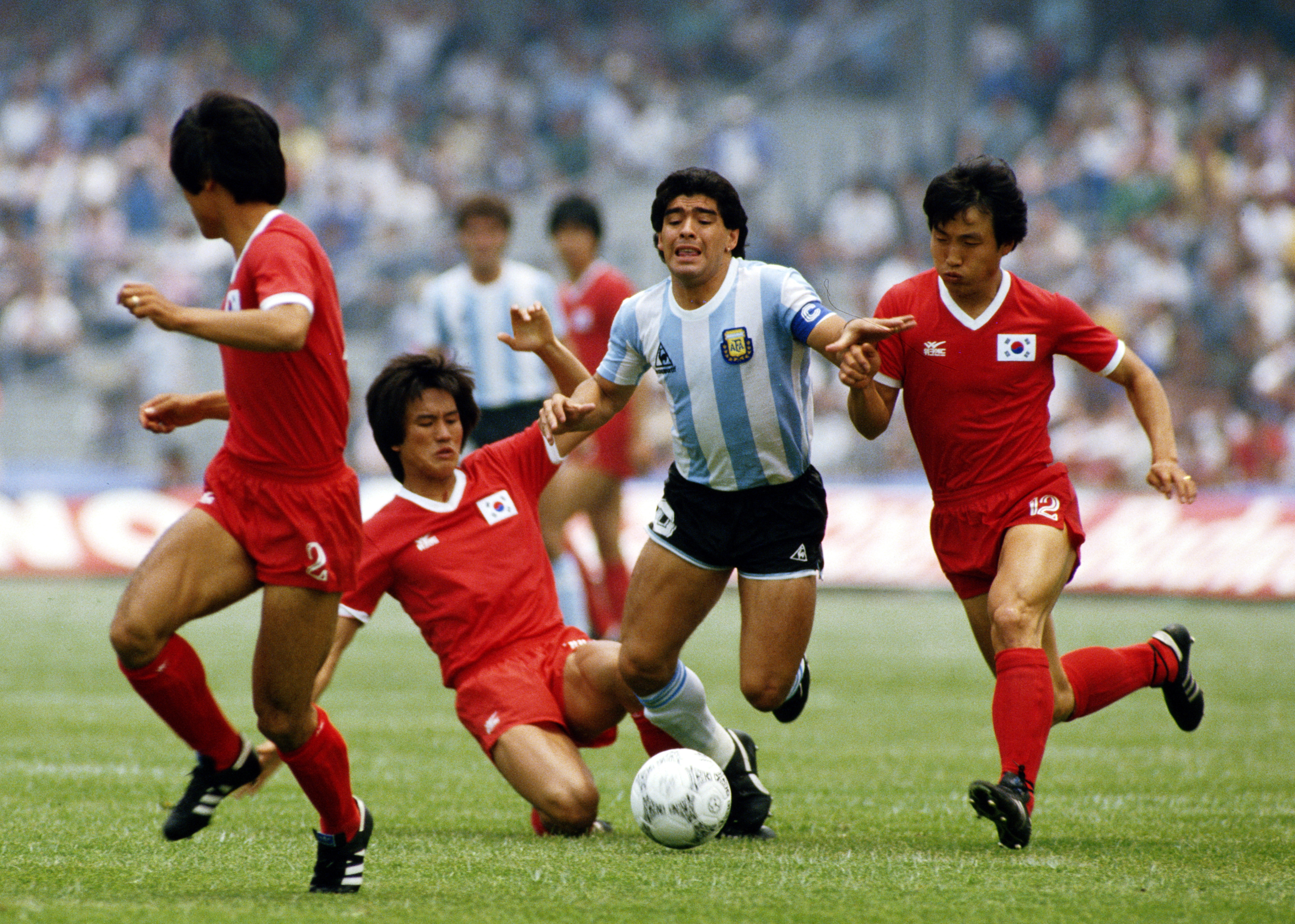 Diego Maradona of Argentina is fouled by players from the Republic of Korea during the Group A match at the 1986 FIFA World Cup on 2 June 1986 at the Olimpico Stadium in Mexico City, Mexico. Argentina defeated the Republic of Korea 3-1. (Photo by David Cannon/Getty Images)